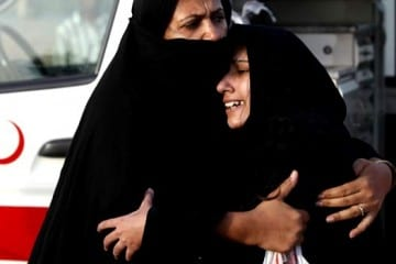 Women mourn the death of their relative, who was killed a day earlier in an attack on Ahmadi worshippers in Lahore, during the funeral in Chanab Nagar, May 29, 2010.