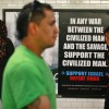 Commuters walk by an advertisement that reads &quot;Support Israel/Defeat Jihad&quot; in the Times Square subway station in New York