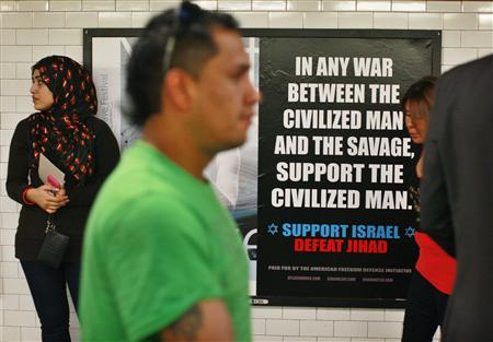 "Commuters walk by an advertisement that reads ""Support Israel/Defeat Jihad"" in the Times Square subway station in New York"