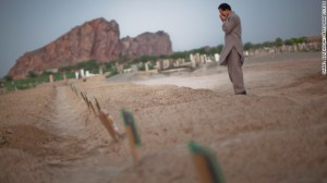 A man cries as he prays at the graves of the victims from the May Lahore attacks against Ahmadiyya community mosques July 14, 2010 in Chenab Nagar, Pakistan.