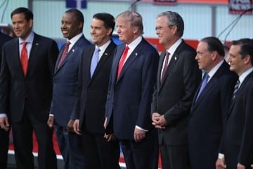 CLEVELAND, OH - AUGUST 06:  Republican presidential candidates (L-R) Sen. Marco Rubio (R-FL), Ben Carson, Wisconsin Gov. Scott Walker, Donald Trump, Jeb Bush, Mike Huckabee and Sen. Ted Cruz (R-TX) take the stage for the first prime-time presidential debate hosted by FOX News and Facebook at the Quicken Loans Arena August 6, 2015 in Cleveland, Ohio. The top-ten GOP candidates were selected to participate in the debate based on their rank in an average of the five most recent national political polls.  (Photo by Scott Olson/Getty Images)