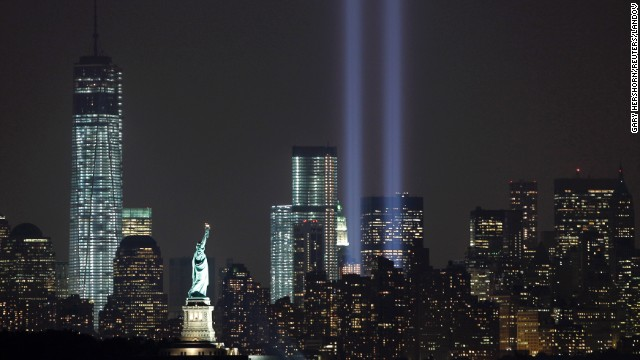 Image #: 24269160    The Tribute in Light is illuminated next to the Statue of Liberty (C) and One World Trade Center (L) during events marking the 12th anniversary of the 9/11 attacks on the World Trade Center in New York, September 10, 2013.  REUTERS/Gary Hershorn (UNITED STATES - Tags: ANNIVERSARY CITYSCAPE DISASTER)       REUTERS /GARY HERSHORN /LANDOV